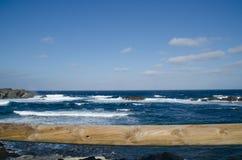 Um dos lugares os mais conhecidos em Menorca na costa com um farol Fotografia de Stock Royalty Free