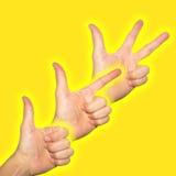Um duas três mãos em uma fileira Fotografia de Stock Royalty Free