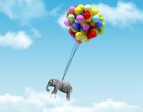 Um elefante que está sendo levantado por balões Fotos de Stock Royalty Free