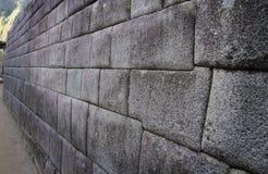 Um exemplo de uma parede mestre-construída em Machu Picchu, Peru Fotografia de Stock