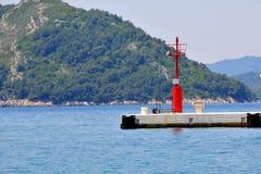 Um farol do porto na ilha de Sipan Fotografia de Stock Royalty Free