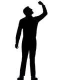 Um fisting irritado do homem de negócio acima da silhueta Imagens de Stock Royalty Free