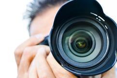 Um fotógrafo que toma a imagem com sua câmera da foto Imagem de Stock Royalty Free