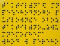 Um fragmento do texto escrito com a ajuda do braile Imagem de Stock