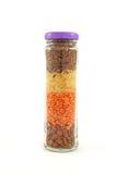 Um frasco completamente de cereais coloridos Fotografia de Stock Royalty Free