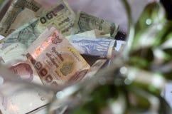 Um frasco da doação com dinheiro Foto de Stock