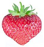 Um fruto rico da morango sob a forma do coração imagens de stock royalty free