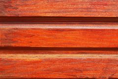 Um fundo com uma madeira marrom Fotografia de Stock