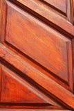 Um fundo com uma madeira marrom Imagens de Stock