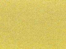 Um fundo do brilho do ouro como uma textura abstrata Fotografia de Stock