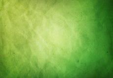 Um fundo textured de Grunge do papel verde fotografia de stock