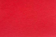 Um fundo vermelho textured com um teste padrão sutil da tela Foto de Stock Royalty Free