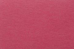 Um fundo vermelho textured com um teste padrão sutil da tela Imagem de Stock