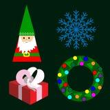 Um grupo de artigos do Natal uma grinalda do Natal, uma Santa, um presente, um floco de neve Fotos de Stock