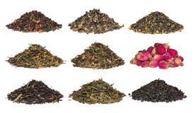 Um grupo de chá erval e floral seco Verde, preto, chás da composição no branco imagens de stock royalty free