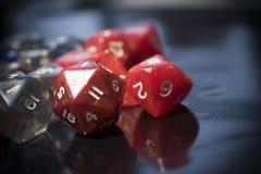 Um grupo de dados vermelhos e transparentes do RPG Fotografia de Stock