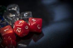 Um grupo de dados vermelhos e transparentes do RPG Imagem de Stock