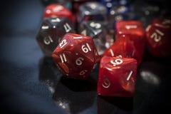 Um grupo de dados vermelhos e transparentes do RPG Fotos de Stock