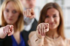 Um grupo de executivos apontando seu Imagens de Stock Royalty Free