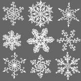 Um grupo de floco de neve preto e branco desenhado à mão imagens de stock