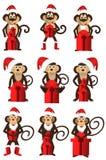 Um grupo de macacos do Natal com presentes Foto de Stock Royalty Free