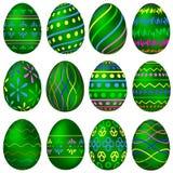 Um grupo de ovos da páscoa verdes com testes padrões coloridos Fotografia de Stock