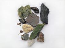 Um grupo de pedras diferentes em um fundo branco Foto de Stock Royalty Free