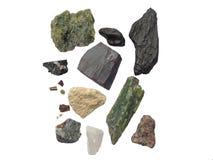 Um grupo de pedras diferentes em um fundo branco Fotos de Stock