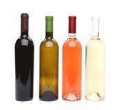 Um grupo de quatro tipos do vinho Foto de Stock Royalty Free