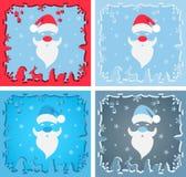 Um grupo de Santa Claus em um fundo azul Imagem de Stock