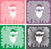 Um grupo de Santa Claus em um fundo colorido Fotos de Stock