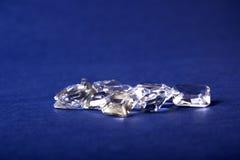 Um grupo dos cristais em um fundo azul Fotos de Stock Royalty Free