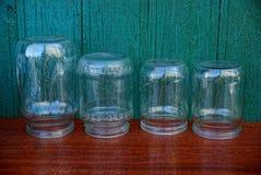 Um grupo dos frascos de vidro em uma tabela Fotos de Stock