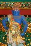 Um guardião na porta de Yashamon no santuário de Taiyuinbyo Imagens de Stock