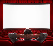 Um homem apenas no salão vazio do cinema Imagens de Stock