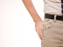 Um homem com dinheiro em seu bolso Fotos de Stock Royalty Free