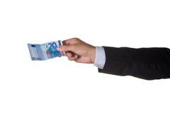 Um homem de negócio com euro vinte Fotografia de Stock