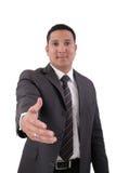 Homem de negócio com uma mão aberta Imagens de Stock