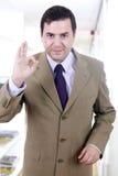 Um homem de negócio feliz considerável novo que gesticula o sucesso no escritório Imagens de Stock Royalty Free