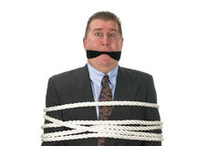 Um homem de negócios acima amarrado imagens de stock