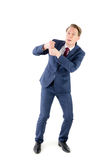 Um homem de negócios ansioso que puxa algo Imagem de Stock Royalty Free