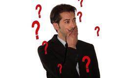 Um homem de negócios com muitas perguntas video estoque