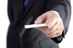 Um homem de negócios com um cartão em branco Fotografia de Stock
