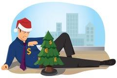 Um homem de negócios decora a árvore de Natal com as moedas Foto de Stock
