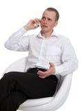 Um homem de negócios em uma conversação foto de stock royalty free
