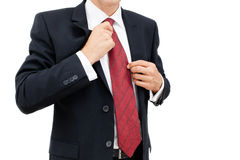 Um homem de negócio que obtém vestido e apronta-se para o trabalho Fotografia de Stock Royalty Free