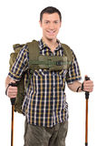 Um homem de sorriso com trouxa e pólos da caminhada Imagens de Stock Royalty Free