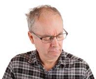 Um homem está em pensamentos profundos Foto de Stock