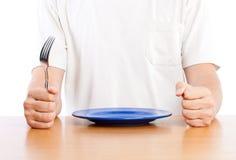 Um homem está esperando um jantar Fotos de Stock Royalty Free