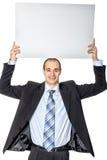 Um homem guarda um cartaz. Imagem de Stock Royalty Free